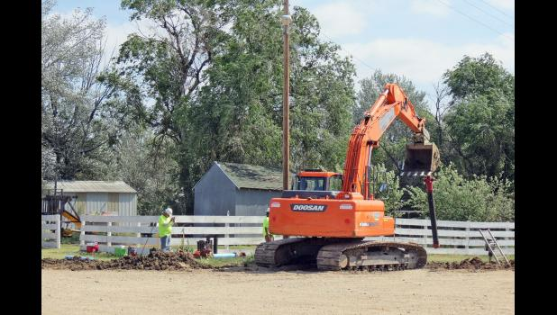 Workers and heavy equipment crowds do the continuing work involved in the Midland water project.